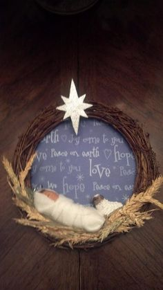This small wreath has a handmade baby Jesus and lamb made from polymer clay.  This one sits on an easel but can make larger ones.