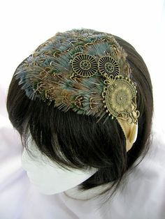Steampunk feather fascinator Ozion design by CastleMemories-- looks like something you might like, @Brittany Wilson!