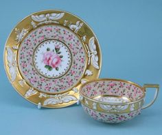 COALPORT  Unusual Egyptian style tea cup & saucer decorated with roses.   1810 to 1815