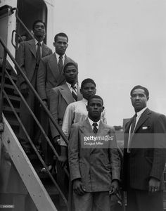 From the top, hopeful Jamaican boxers Charles Smith, Ten Ansel, Essi Reid, John Hazel, Boy Solas and manager Mortimer Martin arrive at Tilbury on the Empire Windrush in the hope of finding work in Britain.