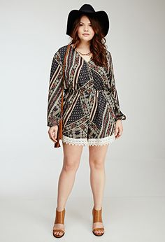 long-sleeved romper with its eye-catching geo print! It lends a sultry and comfy touch with its surplice neckline and elasticized waist. We're particularly fond of its delicate crochet trim (and we think you will be too).