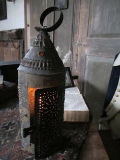 19th century punched tin lantern in paint