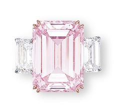 THE PERFECT PINK  A SUPERB COLOURED DIAMOND AND DIAMOND RING Set with a rectangular-shaped fancy intense pink diamond weighing 14.23 carats, flanked on either side by a rectangular-shaped diamond weighing 1.73 and 1.67 carats, mounted in 18k rose and white gold, ring size 5½