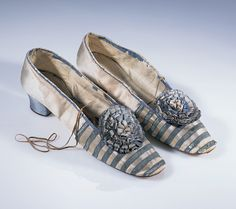 Women's satin shoes trimmed with blue ribbon, 1850s - 60s.