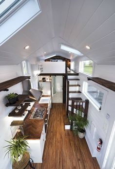 Inside the custom Napa Edition are white walls, ceiling, and cabinetry. Rich wood finishes contrast the white and add warmth to the home. house design Custom Napa Edition by Mint Tiny Homes - Tiny Living Tiny Houses For Rent, Tiny House Loft, Tiny House Living, Tiny House Plans, Tiny House On Wheels, Tiny House Design, Small Houses, Tiny House Bedroom, House And Home