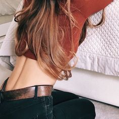black jeans orange/maroon long sleeve shirt long wavy blonde hair back spine skin lower back lumbar #aicampus