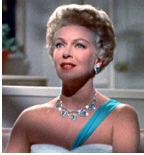 """Every time I see Lana Turner in """"Imitation of Life"""" I want to cut my hair short and wear too many jewels.   Google Image Result for http://www.brightlightsfilm.com/18/18_images/imitation_turner.jpg"""