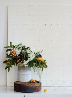 Flower arrangement using oranges