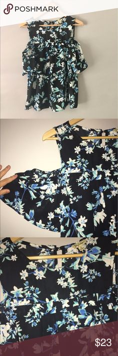 """Cold Shoulder Flutter Sleeve Floral Top This SUPER CUTE and on trend cold shoulder top has feminine flutter sleeves.  Keyhole closure in back.  Great colors: black, blue, white and a touch of green.  Excellent condition.  100% poly - machine washable.  Size medium. Shoulder to hem approximately 26"""" and 19"""" across bust. Lily White Tops Blouses"""