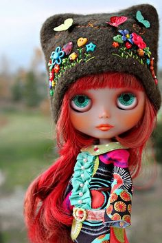 Hippy Blythe with red hair and gorgeous multicoloured hat