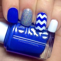 Blue, sparkle, white, and a zigzag nails