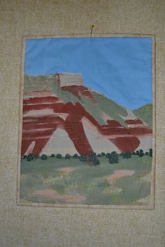 Palo Duro ala Georgia.  Quilt in the style of a favorite artist.  This is an adeptation of a photo of Palo Duro Canyon in the style of Georgia O'Keefe.  Research found that she taught a year at the community college in the area, and viewed these same hills.  Painted and thread sketching.