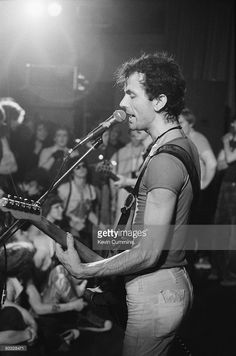 Hugh Cornwell, singer and guitarist with the Stranglers performs on stage at the Top Rank in Sheffield on June 12, 1977.