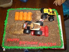 This was a super easy cake to make for my son's birthday. I used a chocolate sheet layers. I also made a cake in a loaf pan to make the ramps. Truck Birthday Cakes, Birthday Sheet Cakes, Truck Cupcakes, Monster Cupcakes, Easy Cakes To Make, How To Make Cake, Monster Jam, Monster Trucks, Monster Truck Birthday