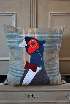 Handmade in the Cotswolds, these original cushions are a great way to add character to any room. They make great gifts for country and animal lovers alike. This snooty pheasant is sat on a checkered/tweed wool background filled with a British made duck feather Pad.