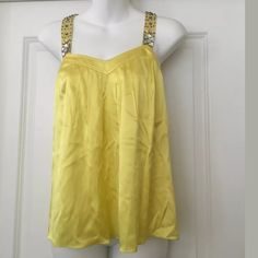 """Rebecca Taylor yellow beaded rhinestone tank Sz 2 Gorgeous blouse !   REBECCA TAYLOR YELLOW TANK TOP BEADED AND EMBELLISHED STRAPS V NECKLINE WITH PLEATED DETAIL PLEATED DETAIL ON BACK SIDE HOOK AND EYE AND HIDDEN ZIPPER CLOSURE  SIZE 2  93% SILK 7% SPANDEX IN EXCELLENT CONDITION MEASUREMENTS  BUST 16""""  LENGTH 24""""  Smoke/pet free home Rebecca Taylor Tops Blouses"""