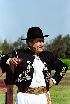 Gaucho in traditional costume drinking local speciality mate tea at Las Brujas Ranch, Uruguay - Photo by Tim Graham