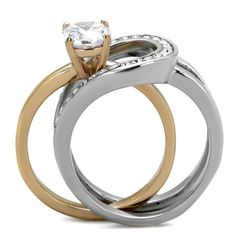 This luxurious ring set features two separate rings, each with high polished stainless steel and a beautiful assortment of cubic zirconia stones that create an elegant and timeless design. The center