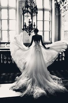 On the move! Do a little twirl and play with your wedding gown's skirt to recreate this graceful portrait.Related: The Most Popular Wedding Photos