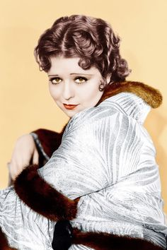 The original 1920s 'It Girl', Clara Bow made a whopping 58 films in 11 years - and her wavy bob, pencil thin eyebrows and cupid's bow pout become as iconic as her on-screen performances.    [b]Signature look:[/b] Flapper style: Short pleated skirts, berets and headscarves, Mary Janes and ankle socks, fur trimmed long coats.