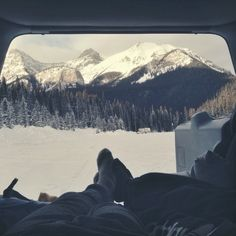 Warm bed, pretty girl, big mountains, perfect mornings. Canadian Rockies.