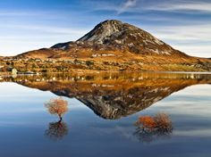 While en route to another photo assignment I was drawn to this perfect reflection of Mount Errigal in the clear still water of Dunlewey Lough.