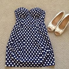 Papaya strapless dress. This dress is a pretty navy blue color with white  polkadots on it!! Pockets hidden within pleats. Great for holding smart phone, your favorite shade of lipstick, or small key chain. This strapless dress is great for the warm spring air!!!  Papaya Dresses Strapless