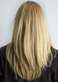 Long straight golden blonde with long razor textured layers hairstyle. I just like the cut. not color :-)