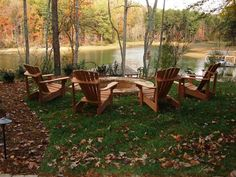 Huge fire pit with Adirondack chairs! Our new lake house has this area with a stone patio surrounding the fire pit. Can't wait to have gatherings there.
