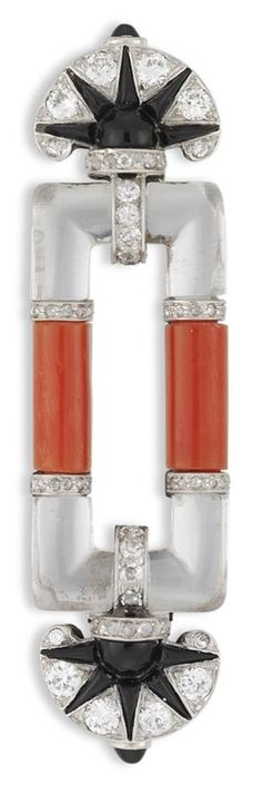 Cartier - An important Art Deco platinum, coral, rock crystal, diamond and onyx brooch, London, circa 1930. Comprising an openwork rectangular plaque with two central coral bars with rock crystal sides, with fan-shaped diamond and onyx terminations, all set to a platinum mount and brooch fitting, signed Cartier London.