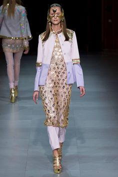 For Spring 2013,Manish Arora is turning this current idea on its ear. Modern-and maybe even a little sci fi- but still  his clothes are grounded in the idea of traditional Indian fashion. Borrowing from the men's wardrobe-a nehru jacket tops tunic and pants.