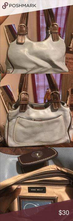 Nine West Purse Blue with brown trim. Barely used... in good shape... Nine West Bags Satchels