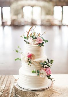 #5 Do NOT like the long green leafs hanging off but LIKE how the topper is arranged with the cake topper with the flowers intwined