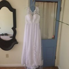 This is a beautiful lacey dress.  The dress is true to a size 8. $250.00 USD