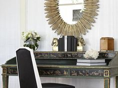 same bedroom, different view. Handpicked accessories make this elegant home office feel like a treasure trove of beloved collectibles –– from the antique writing desk with gold-leaf detail to the sunburst mirror and horse-head bookends. White Writing Desk, Antique Writing Desk, Living Furniture, Luxury Furniture, Furniture Ideas, Sunburst Mirror, Oval Mirror, Headboard Designs, Home Decor Pictures