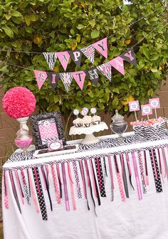 Zebra party - ribbon pieces jazz up the tablecloth. Banner and ribbon garland from atozebracelebrations.etsy.com