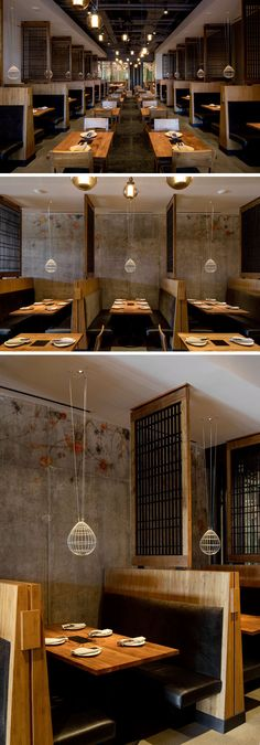 Slatted teak screens separate booths that line both sides of the dining area in this modern restaurant. #RestaurantDesign #BoothDesign