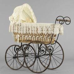 Late eighteenth and early nineteenth century child strollers/prams as beautifully made as the garments of that period.