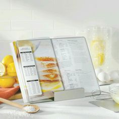 So clever! We love this cookbook holder with glass panel. 1) Because it keeps our cookbooks clean and close at hand. 2( There's a handy conversion chart printed right on it!