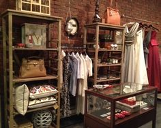Image result for exposed brick wall interior decorating for clothing stores