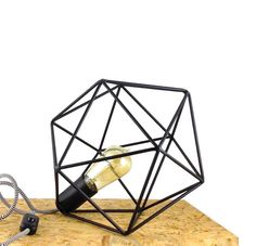Handmade Polyhedron geometric table lamp.  The metal geometric lampshade is inspired by Platonic icosahedron and it is made of metal nerves welded