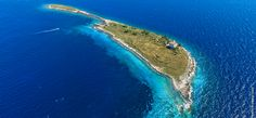 PLOČICA – A puzzle piece that sticks out This island is low and flat, hence the name fits it perfectly because from afar it looks like a plate on the sea's surface. Fish Swimming, Adriatic Sea, Light House, Stick It Out, Folklore, Croatia, Sticks, Puzzle, Surface