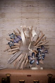 driftwood wreath with mussel shell flowers