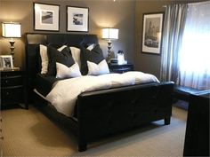 Loving the taupe/grey walls with the charcoal pillows and black and white photos. This is a bedroom that would be very easy the throw together.