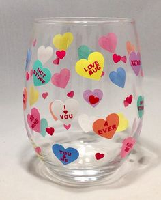 The Candy heart Valentine stemless wine glass is the perfect gift for your girlfriend, boyfriend, wife, husband, fiancé, secret admirer, or special person in your life. The glass is perfect for wine, champagne, sparkling grape juice, punch, or your favorite beverage. The glass is 4 1/2