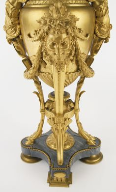 Attributed to Leblanc Barbedienne French, Active late 19th/early 20th century A fine pair of Louis XVI style gilt bronze, cloisonné enamel and bleu turquin marble urns Paris, last quarter 19th century