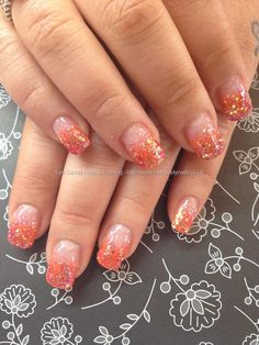Orange glitter fade on acrylic nails