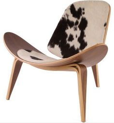 Wegner Shell Chair - Cowhide AVD-SA-CH07-CH - Wegner Shell Chair - Cowhide AVD-SA-CH07-CHAmong Hans Wegner's most famous designs, this three-legged accent chair almost fell into obscurity. After a limited series in 1963, a re-launch in 1997 introduced it to a new generation. Crafted from American walnut veneer on bent plywood,  it has a padded seat and back covered in random black, brown and white cowide.  Not only is the Hans Wegner CH 07 Shell Lounge beautiful and unique, but it is also…