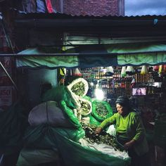 """joshuacogan: """" #Coca leaf vendors bag up product for sale in the #market in #Huancayo . Sometimes it's easy to belief McKenna when he says that plants run the world. On assignment for @smithsonianfolklife #ethnobotany #peru #thehumanlandscape """""""