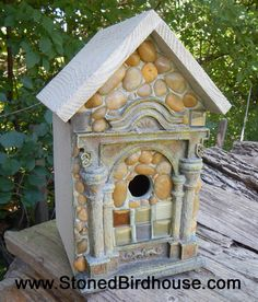 The Attica  Handcrafted birdhouse with river rock embellished front.  Bottom is removable to spring clean out if you will be using it outdoors.  This birdhouse is also suitable of indoor decor'.